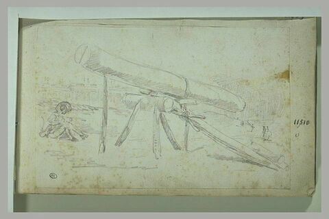 Pièce de bois posée sur un chevalet et un homme assis