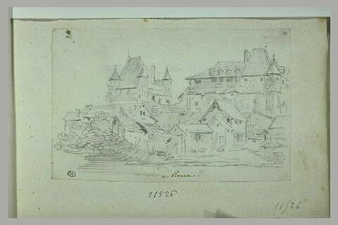 Château médiéval dominant des maisons