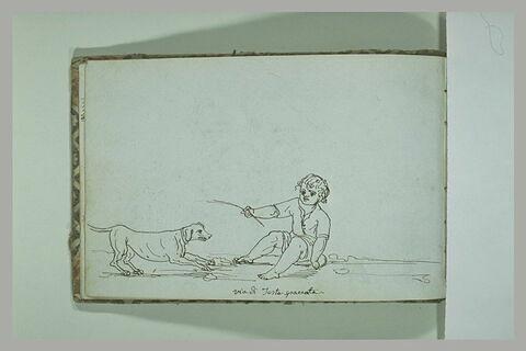 Enfant assis près d'un chien