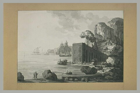 Vue d'un port encadré de rochers