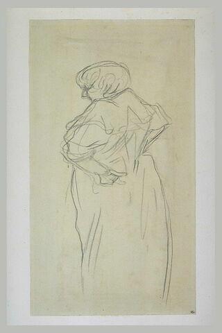 Femme debout, ramenant en arrière ses mains sur ses hanches