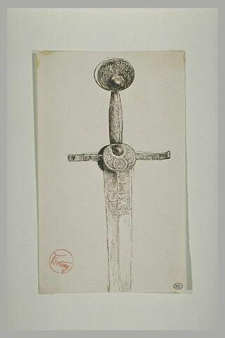 Garde d'épée, en métal ciselé, vue de face