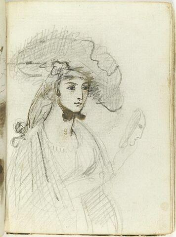 Portrait d'une jeune femme, vue à mi-corps, de trois quarts à droite, tenant un masque