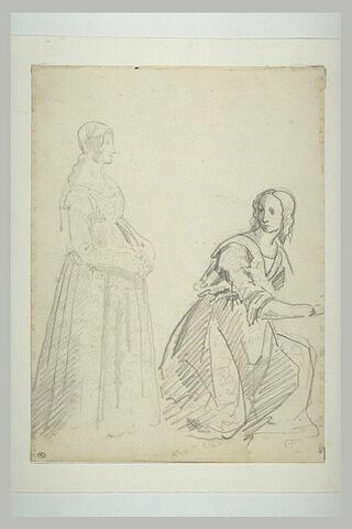 Deux femmes, dont l'une est agenouillée