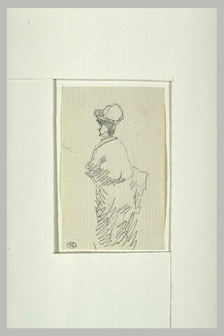 Femme, debout, coiffé d'un chapeau