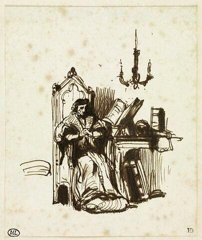 Homme pensif assis près d'une table de travail