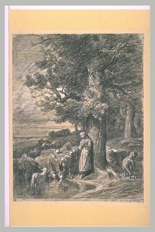 Bergère debout appuyée sur un tronc, gardant un troupeau de moutons