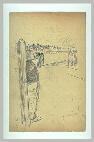 Jeune homme lié à un poteau d'exécution
