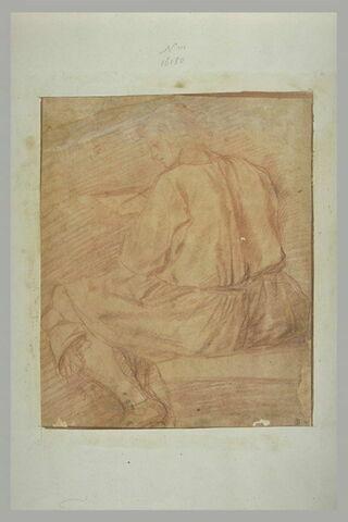 Homme assis, vu de dos, paraissant occupé à peindre