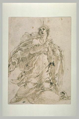 Femme agenouillée, mains jointes