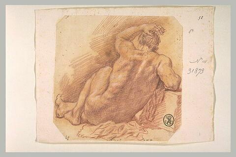 Académie d'un jeune homme assis à terre, vu de dos