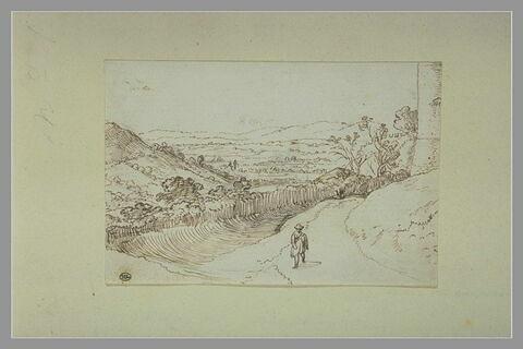 Paysage avec un homme sur un chemin dominant la vallée