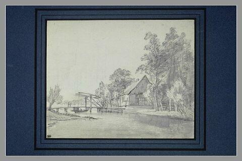 Maison campagnarde au bord d'un canal, avec un pont à bascule
