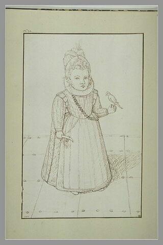 Petite fille avec un oiseau posé sur la main