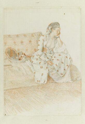Jeune orientale sur un divan en costume turc