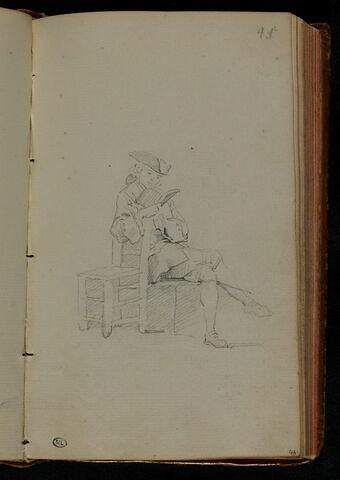 Jeune homme assis et lisant