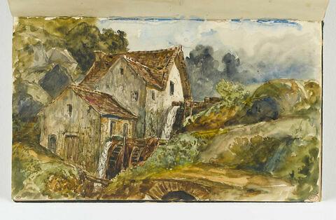Roues hydrauliques dans un paysage de montagne, près de Pont d'Ouilly