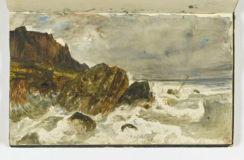 Les vagues se brisant sur les rochers dans la mer, à Houlgate