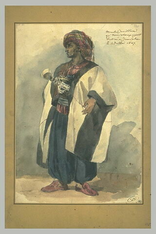 Oriental coiffé d'un turban bariolé et habillé d'un caftan blanc