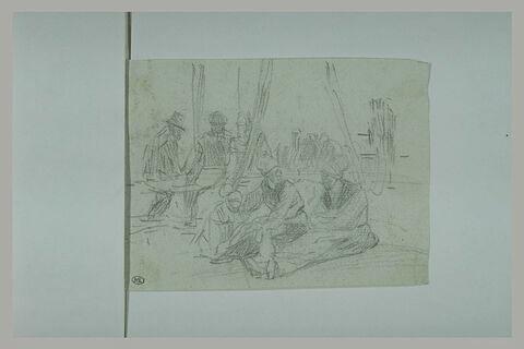 Deux femmes et un enfant, assis par terre