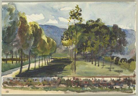 Paysage : jardin séparé par un mur d'une pelouse ombragée d'arbres