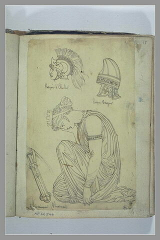 Deux casques antiques ; femme grecque vaincue