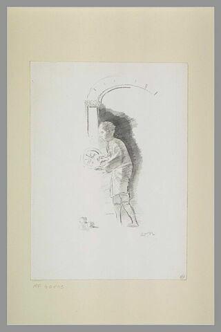 Adolescent tenant une roue, trois boules à ses pieds