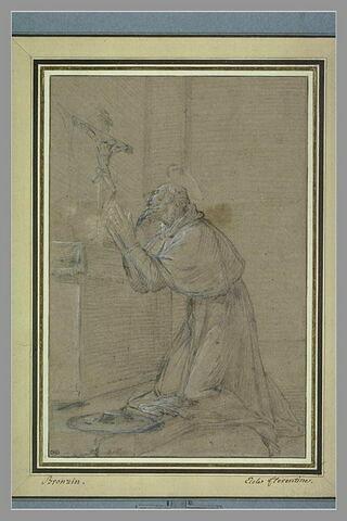 Saint Antoine à genoux devant un crucifix