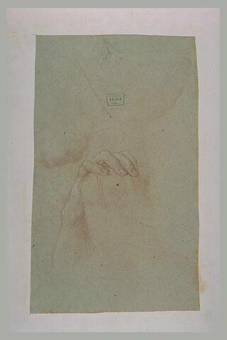 Main posée sur un livre, et profil caricatural