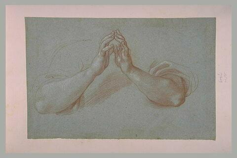 Deux mains jointes, en geste de prière