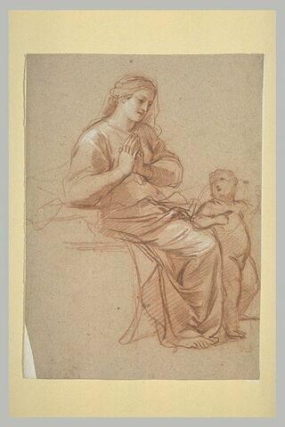 Femme assise, un enfant près d'elle