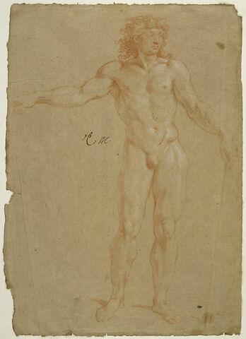 Homme nu, debout, vu de face, un bâton dans la main gauche