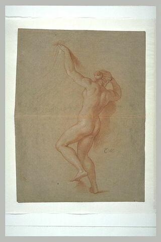 Femme nue, vue de dos, le bras gauche levé
