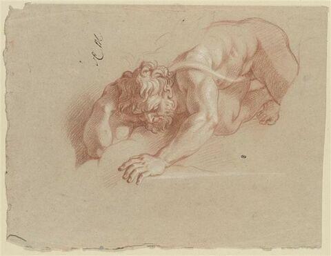 Homme barbu, nu, étendu à terre