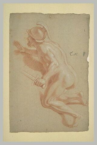 Homme nu, casqué, à genoux