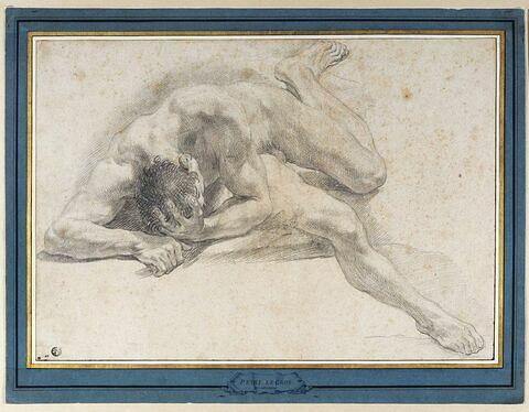 Homme nu, au sol, la tête dans la main gauche
