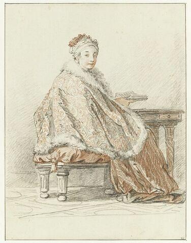 Femme russe assise tenant un livre à la main
