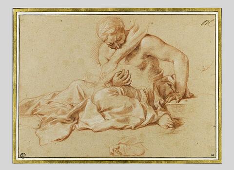 Femme assise, tenant un enfant