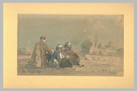 Deux musiciens assis par terre, au Caire