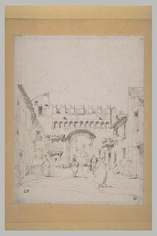 Vue d'une rue terminée par une porte crénelée à Vénise