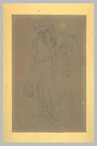 Deux arabes portant des fardeaux, l'un avec des têtes de mouton à la main