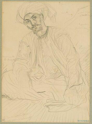 Arabe assis par terre, de face, la tête enturbannée
