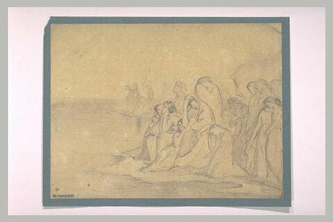 Groupe de femmes se lamentant sur une plage