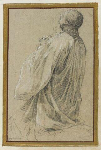 Novice jésuite agenouillé, de profil, à gauche, mains jointes
