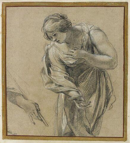 Femme penchée en avant, et main tenant une baguette