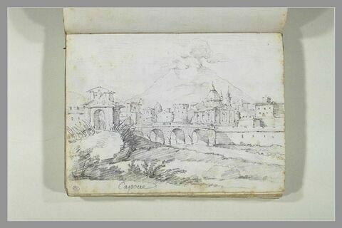 Vue de Capoue, un pont précédé d'une porte monumentale franchit une...