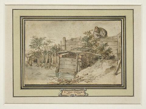 Paysan derrière une palissade, penché au dessus d'un puits