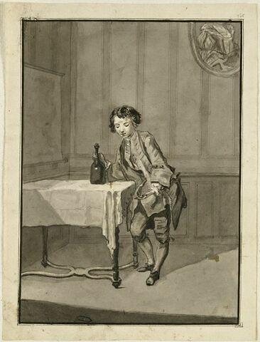 Jeune garçon tenant de la main droite une bouteille posée sur une table
