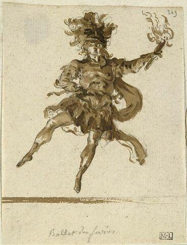 Un danseur tenant une torche de la main gauche