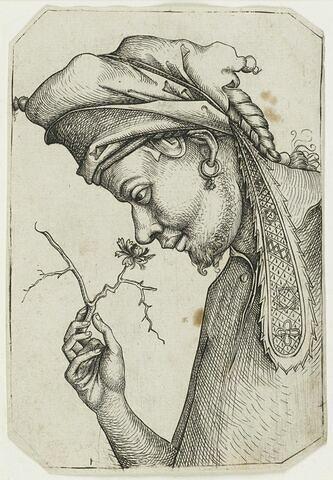 Buste d'un homme sentant une fleur